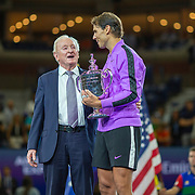 2019 US Open Tennis Tournament- Day Fourteen.   Rafael Nadal of Spain with the winners trophy and tennis legend Rod Laver who presented the trophy after his victory against Danill Medvedev of Russia in the Men's Singles Final on Arthur Ashe Stadium during the 2019 US Open Tennis Tournament at the USTA Billie Jean King National Tennis Center on September 8th, 2019 in Flushing, Queens, New York City.  (Photo by Tim Clayton/Corbis via Getty Images)