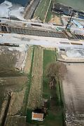 Nederland, Hoeksche Waard, Wachtdijk, 08-03-2002; HSL trace: de dijk, een secondaire waterkering, wordt doorsneden door de toerit van de HSL naar de tunnel de Dordtsche Kil; infrastructuur verkeer en vervoer spoor  heistellingen landschap damwanden (detailfoto, zie ook overzichtsfoto's);<br /> luchtfoto (toeslag), aerial photo (additional fee)<br /> foto /photo Siebe Swart