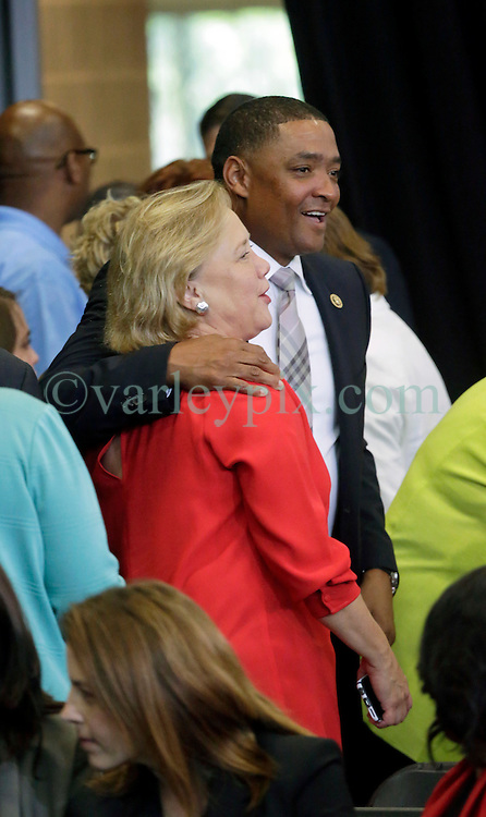 27 August 2015. Andrew P. Sanchez & Copelin-Byrd Multi Service Center, Lower 9th Ward, New Orleans, Louisiana.<br /> Mary Landrieu (in red - former Senator for Louisiana) with Congressman Cedric Richmond before President Barack Obama speaks. <br /> Photo credit©; Charlie Varley/varleypix.com.