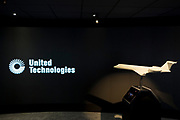 A model of a generic aircraft and the images from a video presentation in the exhibition chalet of United Technologies, at the Farnborough Airshow, on 16th July 2018, in Farnborough, England. United Technologies are the parent company to  Otis,, UTC Climate, Controls & Security, Pratt & Whitney and UTC.