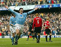 Photo. Aidan Ellis.<br /> Manchester City v Manchester United.<br /> FA Barclaycard Premiership.<br /> 14/03/2004.<br /> Jon Macken celebrates his goal and city's second