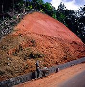 Red laterite soil exposed following a landslide, Praslin, Seychelles