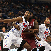 Yanick Moreira, (front), SMU and Mark Williams, Temple, prepare to challenge for a rebound from a free throw during the Temple Vs SMU Semi Final game at the American Athletic Conference Men's College Basketball Championships 2015 at the XL Center, Hartford, Connecticut, USA. 14th March 2015. Photo Tim Clayton