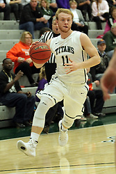 17 November 2015:  Colin Bonnett(11) dribbles his way to the 3 point line during an NCAA men's division 3 CCIW basketball game between the Greenville College Panthers and the Illinois Wesleyan Titans in Shirk Center, Bloomington IL