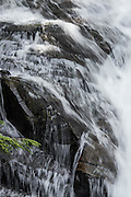 Water flows down the edge of Madcap Falls.