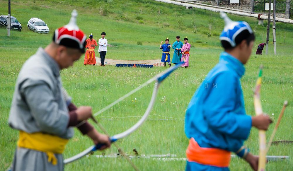 Boy archers getting ready to aim at their target, Nadaam Festival, Erdenet, Mongolia. Photo © Robert van Sluis - www.robertvansluis.com