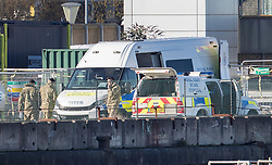 © Licensed to London News Pictures. 12/02/2018. London, UK. Members of the Royal Navy Bomb Disposal Team gather near London City Airport which remains closed after a World War II era bomb was found in The River Thames during routine work on nearby King V Dock. Police have evacuated nearby residents, closed the airport and set up a 214-metre exclusion zone. Photo credit: Peter Macdiarmid/LNP