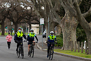 Police patrol on bicycles along the Yarra River during COVID-19 in Melbourne, Australia. Victoria has recorded 14 COVID related deaths including a 20 year old, marking the youngest to die from Coronavirus in Australia, and an additional 372 new cases overnight. (Photo by Dave Hewison/Speed Media)