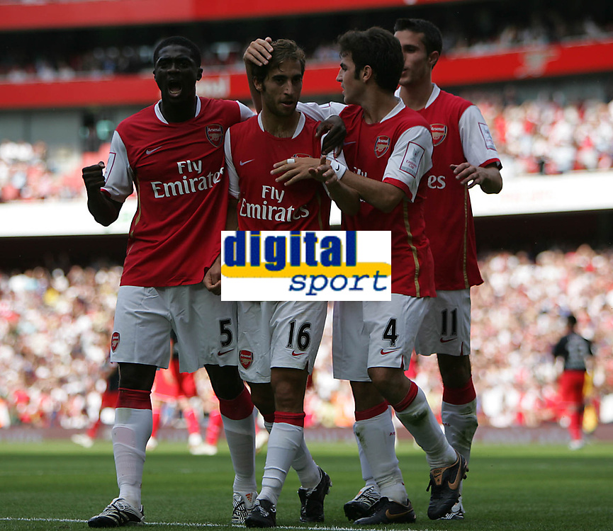 Photo: Lee Earle.<br /> Arsenal v Paris Saint-Germain. The Emirates Cup. 28/07/2007.Arsenal's Mathieu Flamini (2ndL) is congratulated after scoring their opening goal.