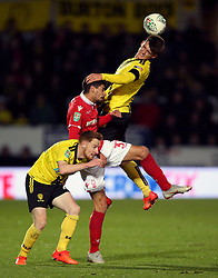 Nottingham Forest's Gil Dias (centre) and Burton Albion's Ben Fox (right) battle for the ball during the Carabao Cup, Fourth Round match at the Pirelli Stadium, Burton.