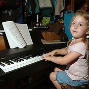 4 year old girl plays piano
