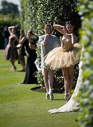 © licensed to London News Pictures.  19/05/2011. London, UK. Photo call for Ballet Meets High Fashion at Kensington Palace. Dancer from the English National Ballet wearing designer tutu's pose in the gardens at Kensington Palace today (19/05/2011). The couture garments will be sold at an auction on the night of the English National Ballet Summer Party. See special instructions for usage rates. Photo credit should read Ben Cawthra/LNP