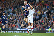 Scotland forward Oliver McBurnie (9) (Swansea City)  outjumps Portugal defender Ruben Dias (6) (Benfica)  during the Friendly international match between Scotland and Portugal at Hampden Park, Glasgow, United Kingdom on 14 October 2018.