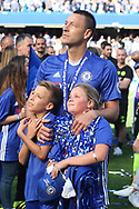Chelsea Captain John Terry holds back the tears as he looks on with his children after the game.  Premier league match, Chelsea v Sunderland at Stamford Bridge in London on Sunday 21st May 2017.<br /> pic by Steffan Bowen,  Andrew Orchard sports photography.