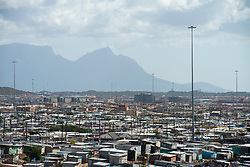 """The densely-populated Khayelitsha, in Cape Town, is seen during South African lockdown on April 7, 2020. Originating during Apartheid, more than a million people are now estimated to be living in the township, many in crowded and difficult conditions. <br /> Households are often large and many families live at close proximity, making social distancing and """"lockdown"""" difficult to implement. Many households don't have access to water and sanitation and communal toilets are shared by many. PHOTOS: EVA-LOTTA JANSSON"""