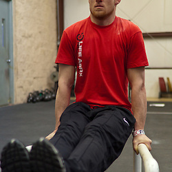 Josh Corley does an L-sit, Crossfit image, picture, photo, photography of health, elite, exercise, training, workouts, WODs, taken at Progressive Fitness CrossFit,Colorado Springs, Colorado, USA.