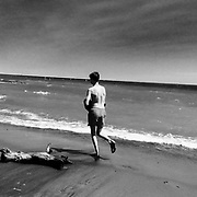 There's an innocent kind of awkwardness in this boy's posture as he runs - yet the joyous sense of freedom comes through - running in the sand along the water's edge.