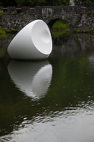 """""""Floating Sculpture Sapporo"""" by Marta Pan.  Sapporo Art Park displays the works of 65 artists, including pieces by modern Japanese sculptors and other works by artists from Sapporo's sister cities.  The artists of these works visited the park to fit their sculptures into the landscape considering the conditions, landscape and the climate of Sapporo. These sculptures show various expressions according to the time and the weather of northern Japan, which varies greatly from season to season. Strolling through the woods you encounter these sculptures among the trees in the open air."""