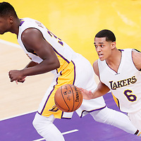 15 November 2015: Los Angeles Lakers guard Jordan Clarkson (6) brings the ball up court next to Los Angeles Lakers forward Julius Randle (30) during the Los Angeles Lakers 97-85 victory over the Detroit Pistons, at the Staples Center, Los Angeles, California, USA.