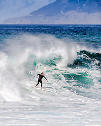 Big Surf, Big Sur, Surfer.  A storm created surfing opportunites not seen often on California's Central Coast