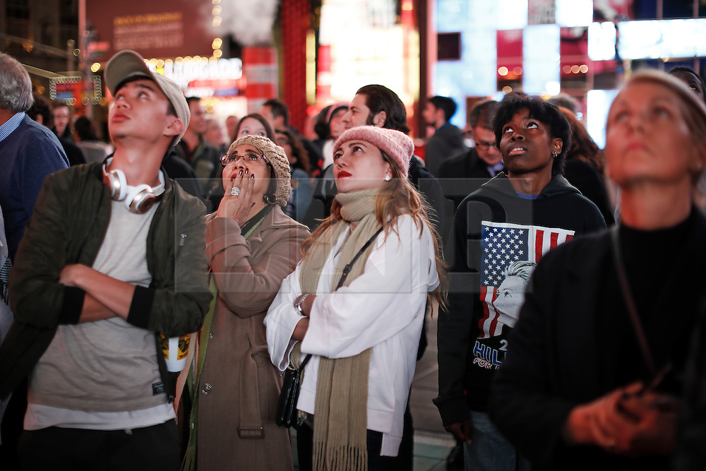 © Licensed to London News Pictures. 09/11/2016. New York City, USA. A group of Hilary Clinton supporters look disappointed as she reacts to news that Donald Trump looks likely to be elected as the next president of the United States, while gathering in Times Square, New York City, on Wednesday, 9 November. Photo credit: Tolga Akmen/LNP