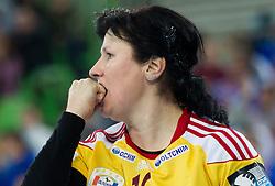 Luminita Dinu of Valcea reacts during handball match between RK Krim Mercator and CS Oltchim RM Valcea (ROU) of Women's EHF Champions League 2011/2012, on February 4, 2012 in Arena Stozice, Ljubljana, Slovenia. Valcea defeated Krim 31-25. (Photo By Vid Ponikvar / Sportida.com)