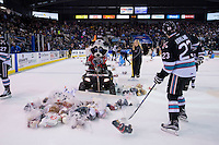 KELOWNA, CANADA - DECEMBER 5: Rocky Racoon, the mascot of the Kelowna Rockets drives his 2016 Polaris Sportsman ATV to clean up teddy bears after the Kelowna Rockets scored the first goal against the Portland Winterhawks on December 5, 2015 at Prospera Place in Kelowna, British Columbia, Canada.  (Photo by Marissa Baecker/Shoot the Breeze)  *** Local Caption *** Rocky Racoon;