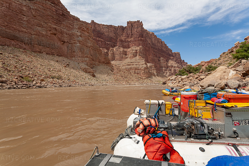 A J-Rig raft in Cataract Canyon — a 46 mile long canyon of the Colorado River located within Canyonlands National Park and Glen Canyon National Recreation Area in southern Utah. Photo © Robert Zaleski / rzcreative.com<br /> —<br /> To license this image for editorial or commercial use, please contact Robert@rzcreative.com