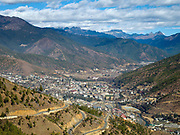 A view of Thimphu from the Buddha Dordenma, Western Bhutan. Thimphu is the capital city and also the name of the valley which has an average elevation of 2300m. With an estimated population of around 100,000 Thimphu is Bhutan's largest city. Rapid expansion following rural exodus has resulted in rebuilding in the city centre and mushrooming suburban development elsewhere. By regulation, all buildings are required to be designed in traditional style with Buddhist paintings and motifs.