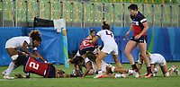 August 08, 2016; Rio de Janeiro, Brazil; USA Women's Eagles Sevens Jillion Potter competes in a breakdown against France during the Women's Rugby Sevens 5th Place Play-Off match on Day 3 of the Rio 2016 Olympic Games at Deodoro Stadium. Photo credit: Abel Barrientes - KLC fotos