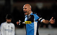 Photo: Richard Lane.<br />Wycombe Wanderers v Chelsea. Carling Cup, Semi Final 1st Leg. 10/01/2007. <br />Wycombe's captain, Tommy Mooney encourages thye fans.