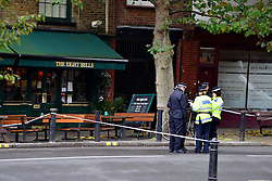 © Licensed to London News Pictures. 26/10/2012. Fulham, UK  Police have launched a murder investigation following the stabbing of a man in Fulham. Officers were called at approx. 18:55hrs on Thursday 25 October to Fulham High Street following reports of an assault. London Ambulance Service and London's Air Ambulance also attended and discovered a man, aged 65, suffering from stab wounds. He was pronounced dead at the scene . Photo credit : Stephen Simpson/LNP