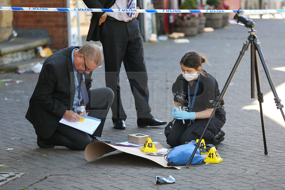 © Licensed to London News Pictures. 29/08/2016. Leeds, UK. Police take evidence at what is believed to be the scene of shooting that took place last night. This is as yet unconfirmed by the police. The incident happened in the Chappeltown area of Leeds where the West Indian Carnival is taking place this weekend. Photo credit : Ian Hinchliffe/LNP