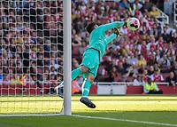 Football - 2019 / 2020 Premier League - Arsenal vs. Tottenham Hotspur<br /> <br /> Hugo Lloris (Tottenham FC) dives to his left to push away the Arsenal shot at The Emirates.<br /> <br /> COLORSPORT/DANIEL BEARHAM