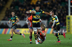 Northampton Saints' Luther Burrell is tackled by Newcastle Falcons Joel Hodgson