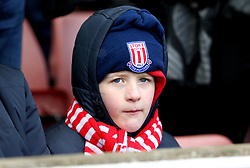 A young Stoke City fan in the stands