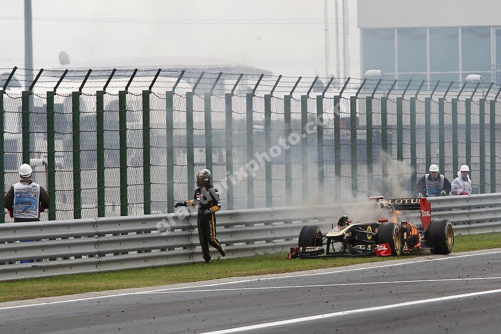 Nick Heidfeld gets out of his burning Lotus-Renault the 2011 Hungarian Grand Prix at the Hungaroring. Photo: Grand Prix Photo