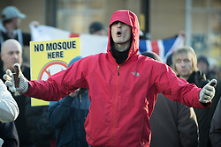 "© Licensed to London News Pictures . 26/11/2016 . Bolton , UK . Those opposed to mosques , pictured at the demonstration . Approximately 100 people attend a demonstration against the construction of mosques in Bolton , under the banner "" No More Mosques "" , organised by a coalition of far-right organisations and approximately 150 anti fascists opposing the demonstration , in Victoria Square in Bolton Town Centre . Photo credit : Joel Goodman/LNP"