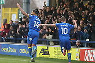 AFC Wimbledon midfielder Liam Trotter (14) and AFC Wimbledon striker Cody McDonald (10) celebrating after scoring goal to make it 1-0 during the EFL Sky Bet League 1 match between AFC Wimbledon and Blackpool at the Cherry Red Records Stadium, Kingston, England on 20 January 2018. Photo by Matthew Redman.