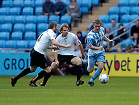Photo: Leigh Quinnell.<br /> Coventry City v Luton Town. Coca Cola Championship.<br /> 29/10/2005. Coventrys Gary McSheffrey shakes off Lutons Marcus Heikkinen and Kevin Nicholls.