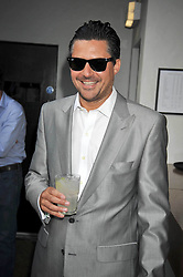 EDWARD TAYLOR at the launch party of the new Embargo 59 nightclub at 533 Kings Road, London on 25th June 2009.