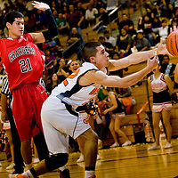 112912  Adron Gardner<br /> <br /> Gallup Bengal Richard Rangel (22) reaches for a ball passing out of bounds on the baseline as Albuquerque Academy Charger Joel Sachs (21) backs off in Gallup Thursday.
