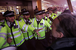 © London News Pictures. 14/05/2016. London, UK. Demonstratorsare held back by police outside of TopShop on Oxford Street in London during a protest agains against Topshop owner Sir Philip Green and the recent suspension of two contract cleaners. Photo credit: Dennis McWilliams/LNP