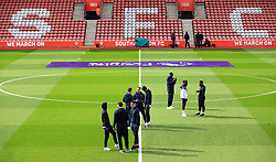 General view of the Tottenham Hotspur players inspecting the pitch before the game