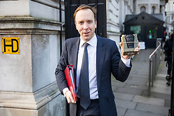 © Licensed to London News Pictures. 16/01/2018. London, UK. Secretary of State for Culture, Media and Sport Matt Hancock leaves Downing Street carrying a reusable coffee cup which he described as 'a gift from Michael Gove'. Photo credit: Rob Pinney/LNP