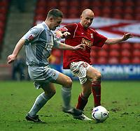 Photo: Dave Linney.<br />Walsall v Bradford City. Coca Cola League 1. 25/03/2006<br />Walsall's (R) try's to halt the progress of  Tom Penford.