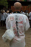 Pilgrims, known as a Henro, pray at shite temple on the Shikoku 88 Temple pilgrimage, Matsuyama, Eihime, Japan.. Friday, June 26th 2015