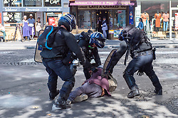 © Licensed to London News Pictures. 21/09/2019. Paris, France. A person is surrounded and detained by police at a climate change demonstration in Paris. Photo credit: Peter Manning/LNP