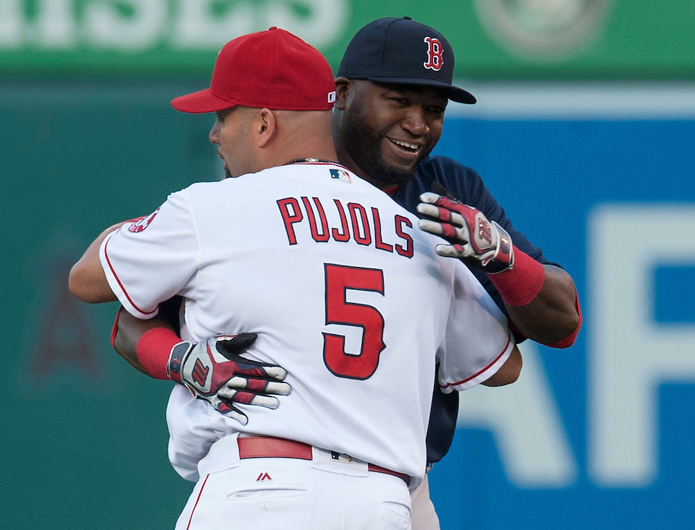 The Angels' Albert Pujols and the Red Sox' David Ortiz hug in the outfield before the Angels' 6-2 loss to the Boston Red Sox at Angel Stadium on Friday.<br /> <br /> ///ADDITIONAL INFO:   <br /> <br /> angels.0730.kjs  ---  Photo by KEVIN SULLIVAN / Orange County Register  -- 7/29/16<br /> <br /> The Los Angeles Angels take on the Boston Red Sox at Angel Stadium.