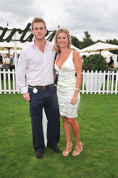 HOLLY BRANSON and FRED ANDREWS at the 25th annual Cartier International Polo held at Guards Polo Club, Great Windsor Park, Berkshire on 26th July 2009.